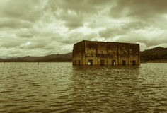 Old temple in the water with sepia color style Stock Images