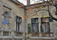 Old tenement house. Details of old tenement house,ruined windows Royalty Free Stock Photography