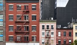 Old tenement houses with fire escapes in New York. City, USA royalty free stock photos