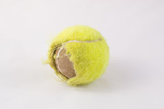 Old tennis ball. Old used tennis ball on white background stock photo