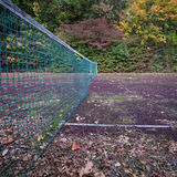 Old tennis court with net Stock Photo