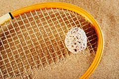 Old tennis racket. On a beach in sand in the summer Royalty Free Stock Images