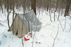 The old tent in the winter forest Stock Images
