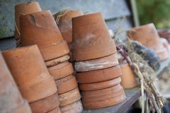 Terra cotta. Old terra cotta pots on a wooden background royalty free stock photos