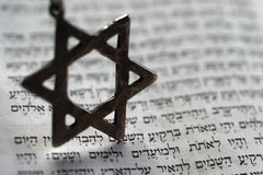 Old testament. Star of David over the first page of the old testament in Hebrew Stock Photos