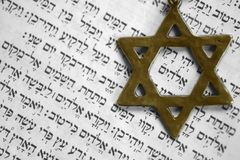 Old testament. Star of David over the first page of the old testament in Hebrew. The word in the center of the star is God Stock Image