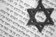 Old testament. Star of David over the first page of the old testament in Hebrew. The word in the center of the star means God. Macro, shallow DOF stock images