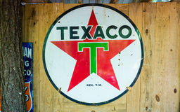 Old Texaco Sign on Wood Wall Royalty Free Stock Images