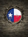 Old Texas flag in brick wall. 3d rendering of a Texas State flag over a rusty metallic plate embedded on an old brick wall Stock Image