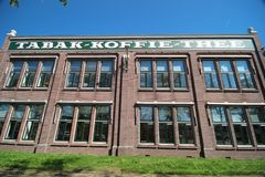 Old text on building of the Jacobs Douwe Egberts coffee factory on the Keulsekade in Utrecht. Old building of the Jacobs Douwe Egberts coffee factory on the stock photos