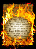 Old text in flame Royalty Free Stock Photo
