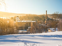 Old textile factory called Klaster, Monastery, with high chimney in winter time, Tanvald, Northern Bohemia, Czech. Republic, Europe royalty free stock image