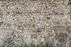 Old texture of a stone brick wall antiquity Stock Photos