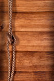 Old texture of wooden boards with ship rope. Stock Photos