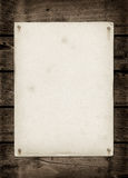 Old textured paper sheet on a dark wood table. Horizontal Mockup stock image