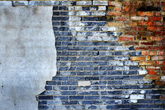 Old Textured Plaster Wall with Bricks and Hole Royalty Free Stock Images