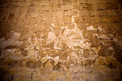 Old textured stone wall background. Old, ancient textured stone wall in Mdina, Malta. Close-up Royalty Free Stock Photo