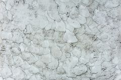 An old textured wall, where the plaster with unfinished work cracked. 2018 Royalty Free Stock Image