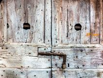 Old Textured Weathered Wooden Door with Padlock. Grunge and Rough Surface for Design Purpose royalty free stock images