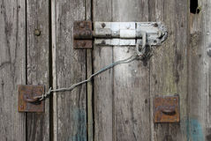 Old textured wood and bolt on an old shed Royalty Free Stock Image