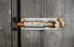 Old textured wood and grungy bolt Stock Image