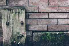 Old Textures of Wood and Brick wall with moss royalty free stock images