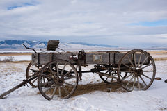 Old 19th Century Pioneer Buckboard Wagon in Winter Stock Photography