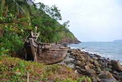 Old Thai boat near the sea. Old Thai fishing boat near the beach on sea background. Thailand stock photos