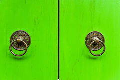 Old thai knocker on the wooden door, Thailand Stock Image