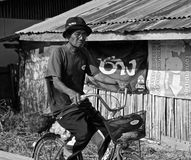 Old thai man on a bicycle Stock Photo