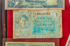 Old Thai one Baht banknotes with king Ananda Mahidol image since Royalty Free Stock Photography
