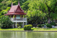 Old Thai Pavilion in the Tropical Garden. Near the Lake Royalty Free Stock Photography