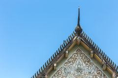 Old Thai style temple roof and blue sky Royalty Free Stock Photography