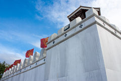 Old thai wall with blue sky Stock Photography