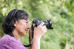 Old thai woman trying to take photo Royalty Free Stock Photos