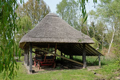 Old Thatched Barn with a  Hay Wagon Stock Image