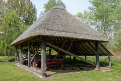 Old Thatched Barn with a  Hay Wagon Royalty Free Stock Photo