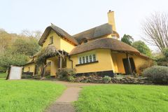 English thatched cottage. An old thatched cottage in the county of Somerset in England Stock Photography