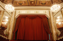 Old theater stage and red curtain Royalty Free Stock Photo