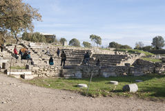 Old theatre. Ruins of the theatre in Troy, Greece with several people Royalty Free Stock Image