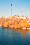 Old thermoelectric power station on the river Stock Photos