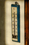 Old thermometer on wall Stock Photo
