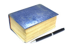 Old thick book blue cover and pen on white background Stock Images