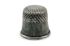 Old thimble. Close-up photo of old thimble isolated on white Royalty Free Stock Photo