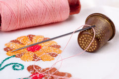 Old thimble and needle with thread Stock Photos