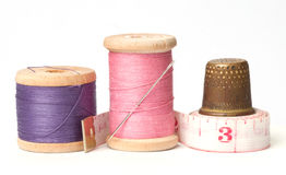 Old thimble and needles with thread. Old thimble and needle with thread and meter Stock Photography