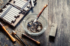 Old thin pipe ready to smoke Stock Images