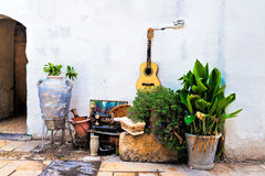 Old things and guitar on the wall Royalty Free Stock Photography