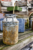 The old things - HDR. Vintage - Metal milk barrel, wooden boxes, fruit cases and other old stuff Stock Images