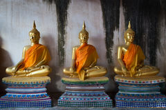 Old three Buddha statue in meditate posture Stock Image